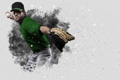 Pitcher Baseball. Player with a green uniform coming out of a blast of smoke Royalty Free Stock Photos