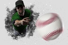 Pitcher Baseball. Player with a green uniform coming out of a blast of smoke Stock Photo