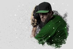 Pitcher Baseball. Player with a green uniform coming out of a blast of smoke Royalty Free Stock Photo