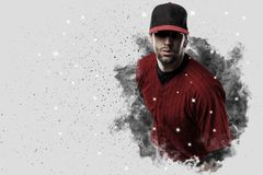 Pitcher Baseball. Player with a red uniform coming out of a blast of smoke Royalty Free Stock Photo