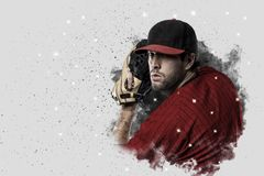 Pitcher Baseball. Player with a red uniform coming out of a blast of smoke Royalty Free Stock Photos