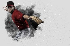 Pitcher Baseball. Player with a red uniform coming out of a blast of smoke Stock Photography