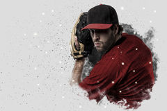Pitcher Baseball. Player with a red uniform coming out of a blast of smoke Royalty Free Stock Photography