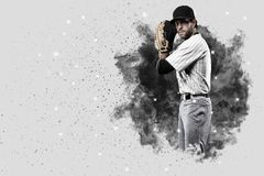 Pitcher Baseball. Player with a white uniform coming out of a blast of smoke Royalty Free Stock Image