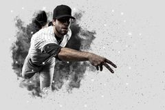 Pitcher Baseball. Player with a white uniform coming out of a blast of smoke Royalty Free Stock Images
