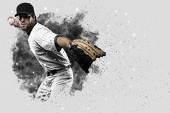 Pitcher Baseball. Player with a white uniform coming out of a blast of smoke Royalty Free Stock Photo