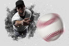 Pitcher Baseball. Player with a white uniform coming out of a blast of smoke Stock Photos
