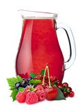Pitcher of berry juice Stock Photo
