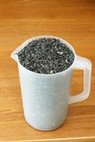 Pitcher of Black Sunflower Seeds Stock Image