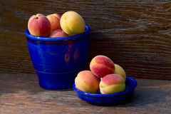Pitcher and bowl with apricots stock photos