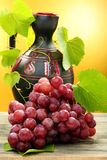 Pitcher and bunch of grapes. Stock Image