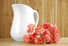 Pitcher and carnations Royalty Free Stock Photo