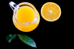 Pitcher of fresh orange juice on black background top view Stock Photography