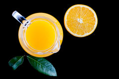 Pitcher of fresh orange juice on black background top view Royalty Free Stock Photography