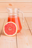 Pitcher full of grapefruit juice. Royalty Free Stock Photography