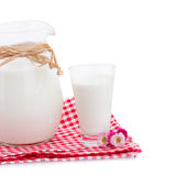 Pitcher full of milk and glass Royalty Free Stock Photos