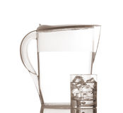 Pitcher and glass with droplets Stock Image