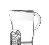 Pitcher and glass with droplets Royalty Free Stock Photos