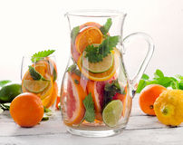 Pitcher and glass with fresh citrus fruits and mint Royalty Free Stock Images
