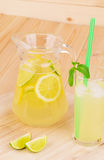 Pitcher and glass full of tasty lemonade. Stock Images