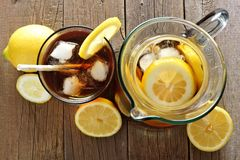 Pitcher and glass of iced tea, downward view on wood Royalty Free Stock Images
