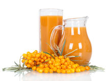 Pitcher,  glass  juice from  berries  sea buckthorn isolated on white. Stock Photography