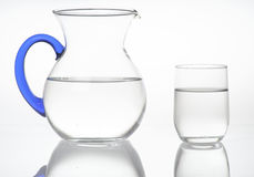 Pitcher and glass of water Stock Photos