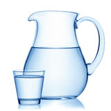 Pitcher and a glass of water. Royalty Free Stock Photo