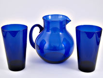 Pitcher & Glasses. A blue pitcher and glass set royalty free stock photos