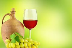 Pitcher with grape wine, glass and bunch grapes Stock Photo