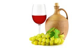Pitcher with grape wine, glass and bunch grapes isolated on whit Stock Images