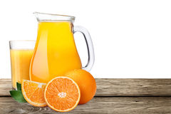Pitcher with highball of orange juice with oranges Royalty Free Stock Image