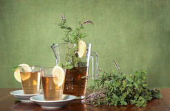 Pitcher of iced tea and a herbal bouquet Royalty Free Stock Photography