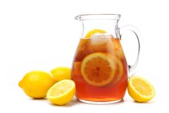 Pitcher of iced tea with lemons isolated on white. Pitcher of iced tea with lemons isolated on a white background Royalty Free Stock Image