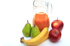 Pitcher of juice. Pears, apples and bananas. Royalty Free Stock Photography