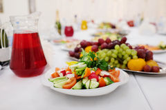 Pitcher of juice and a plate of vegetables Stock Images