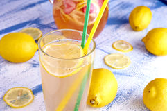 Pitcher of lemonade with lemons, and fresh Royalty Free Stock Images