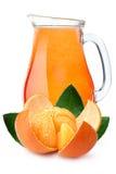 Pitcher of mandarin orange juice Royalty Free Stock Image