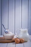 Pitcher with milk bowl flour eggon white painted Royalty Free Stock Image