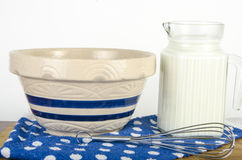 Pitcher of Milk with a bowl with whisk Stock Photo