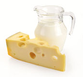 Pitcher of milk and cheese Stock Images