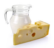 Pitcher of milk and cheese Stock Image