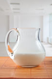 Pitcher with milk on table Stock Images