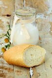 Pitcher of milk and white bread Stock Photography