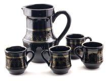 Pitcher and mugs Stock Photo