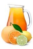 Pitcher of multi-fruit citrus juice royalty free stock image