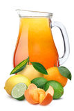 Pitcher of multifruit citrus juice. Multifruit citrus juice pitcher or jug with citrus fruits on foreground. Separate clipping paths for pitcher, for whole Stock Photography