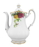 Pitcher with a pattern. Ceramic milk or creamer pitcher with a pattern of roses and gold in classic style Stock Photos