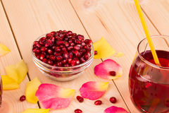 Pitcher of pomegranate juice Stock Images