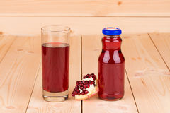 Pitcher of pomegranate juice Stock Image